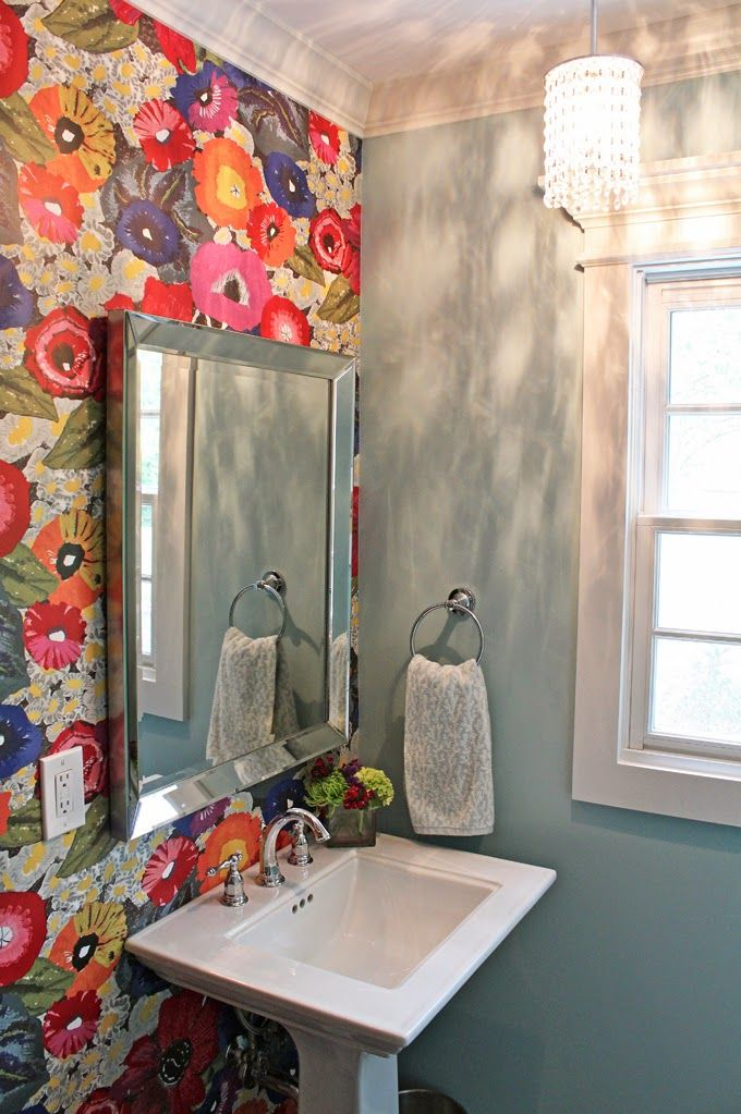 Interior design elements are great inspiration for weddings, too! I love this accent wall of brightly painted poppies on a neutral grey/dusty blue background.